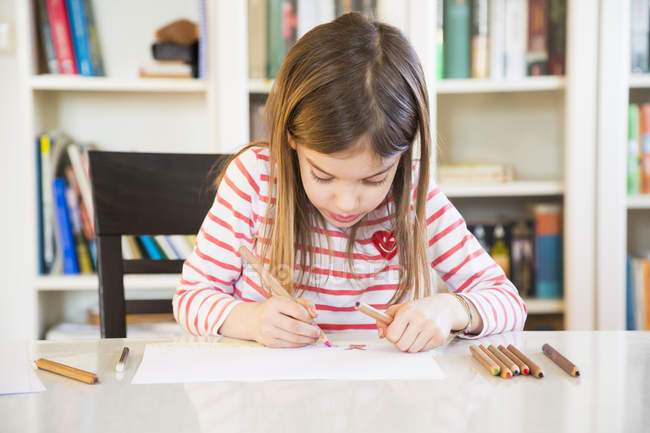 Little girl painting at home — Stock Photo