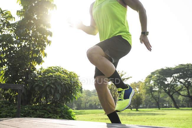Runner training running up stairs, close up — Stock Photo