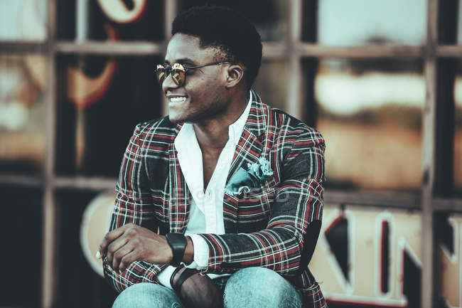 Portrait of fashionable young man wearing checkered suit coat — Stock Photo