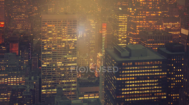 USA, New York, Manhattan, high-rise buildings at night — Stock Photo