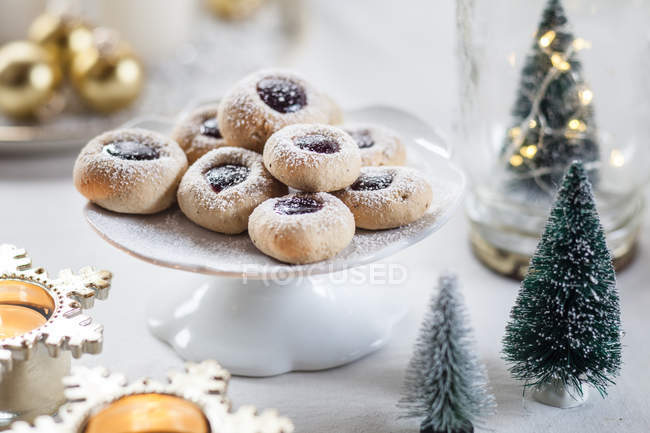 Christmas Cookies With Jam Filling On Cake Stand Color Image