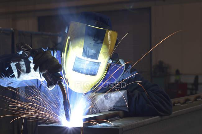 Welder at work in factory — Stock Photo