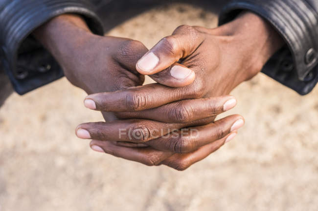 Young north african man, hands folded — Stockfoto