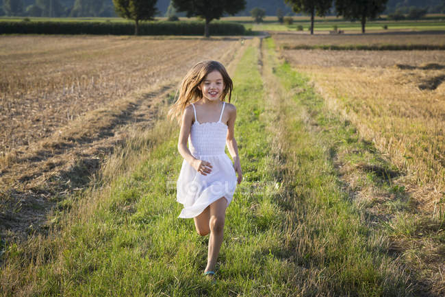 Happy little girl running in nature — Stock Photo