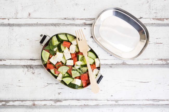 Lunch box, watermelon salad with feta, cucumber, ment and lime dressing — Stock Photo