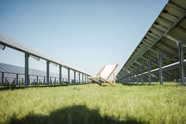 Germany, Kevelaer, solar plant and beach lounger — Stock Photo