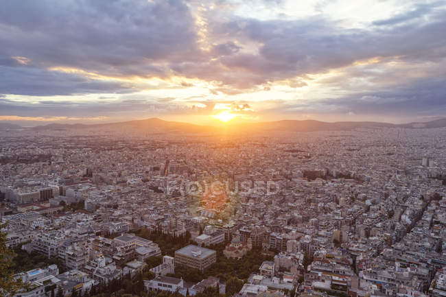 Greece, Attica, Athens, View from Mount Lycabettus over city at sunset — Stock Photo