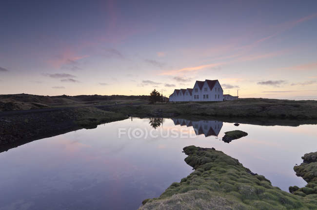 Iceland, Straumur, row houses in the evening light — Stock Photo