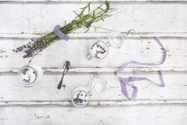 Glasses of homemade lavender sugar with lavender blossoms — Stock Photo