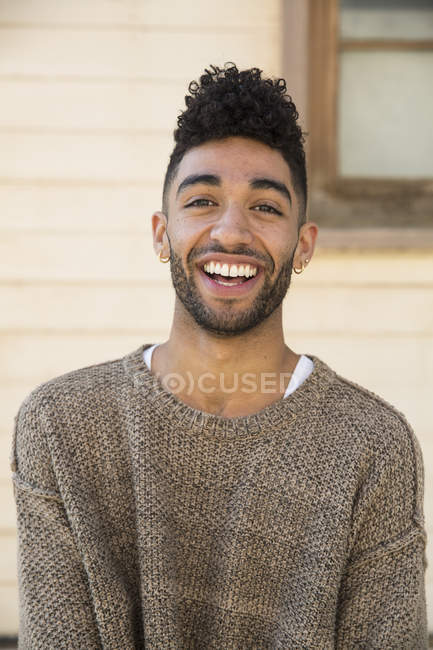 Portrait of happy young man looking at camera — Stock Photo