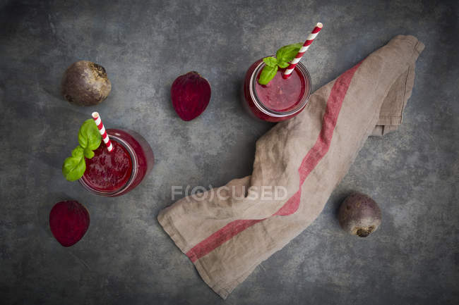 Beet root smoothie with straws — Stock Photo