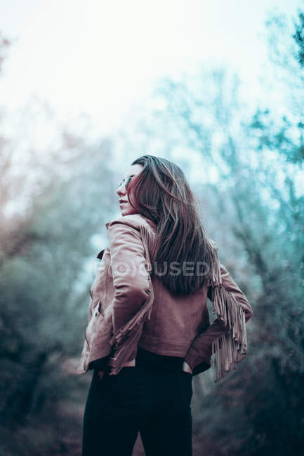Back view of young woman wearing leather jacket — Stock Photo