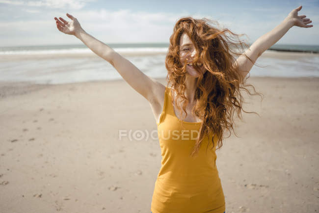 Redheaded woman, laughing happily in the wind — Stock Photo
