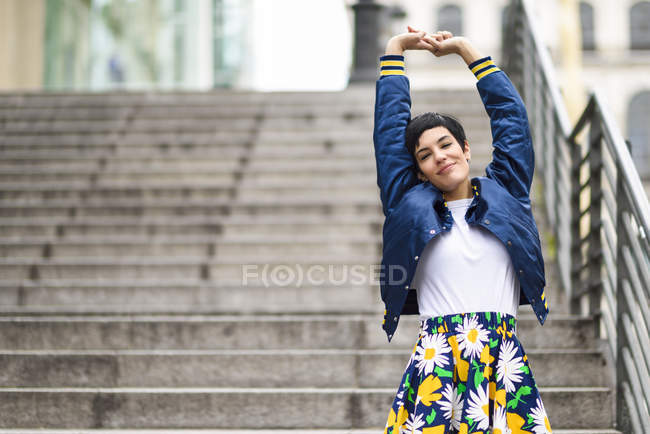 Portrait of fashionable young woman wearing skirt with floral design — Stock Photo