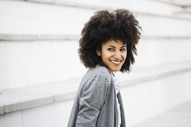 Portrait of laughing woman with curly hair — Stock Photo