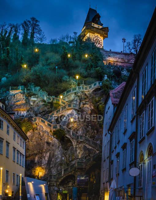 Austria, Styria, Graz, Grazer Schlossberg, castle mountain with staircase, clock tower at night — Stock Photo