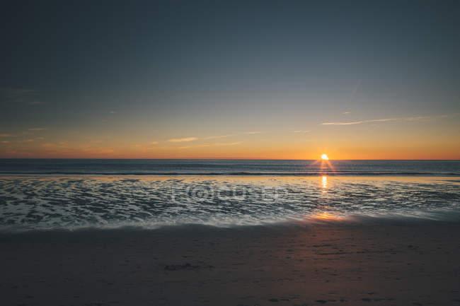Norway, Lofoten, Moskenesoy, Sunset at Kvalvika Beach — Stock Photo