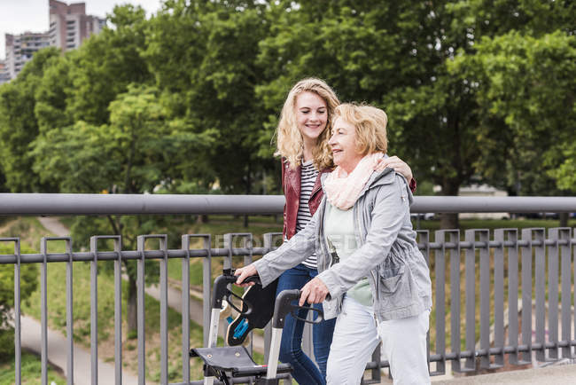 Grandmother and granddaughter strolling together — Stock Photo