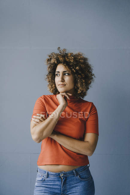 Portrait of a pensive woman with hand on chin — Stock Photo
