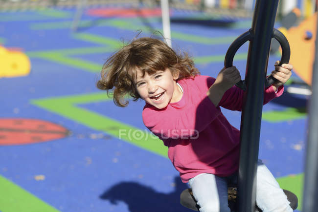 Portrait of happy little girl on  playground — Stock Photo