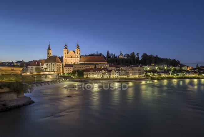 Austria, Upper Austria, Steyr, River Enns and St Michael's Church at blue hour — Stock Photo