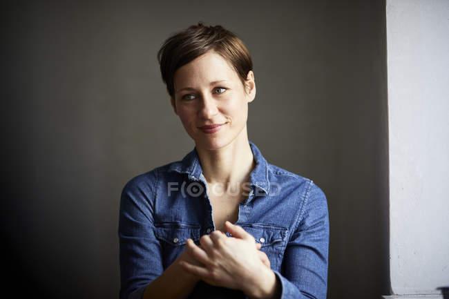 Portrait of ana ttractive woman, wearing denim shirt — Stock Photo
