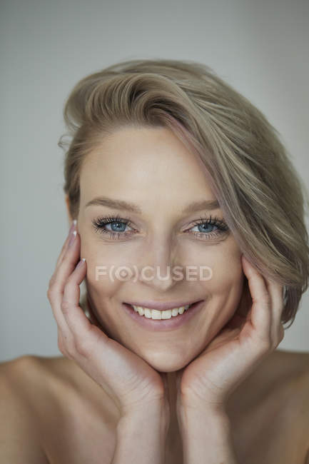 Portrait of smiling beautiful blond woman — Stock Photo