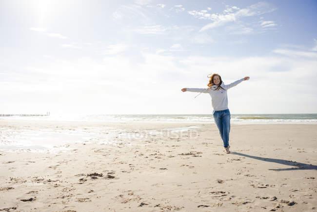 Happy woman having fun at the beach, running at the sea — Stock Photo