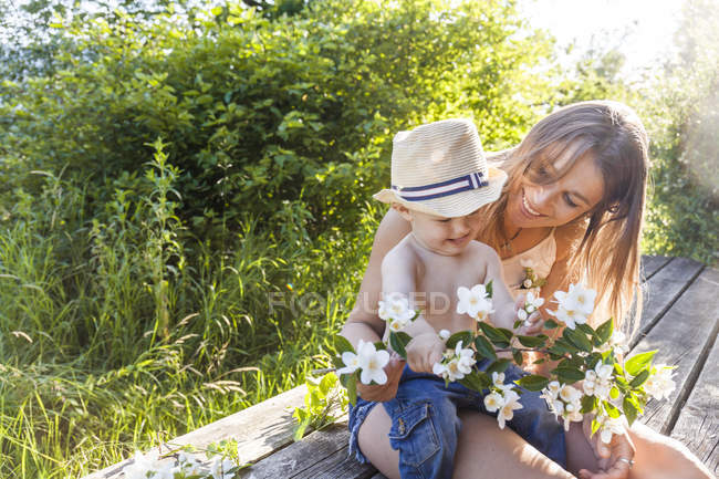 Mother and baby boy having fun together on terrace — Stock Photo