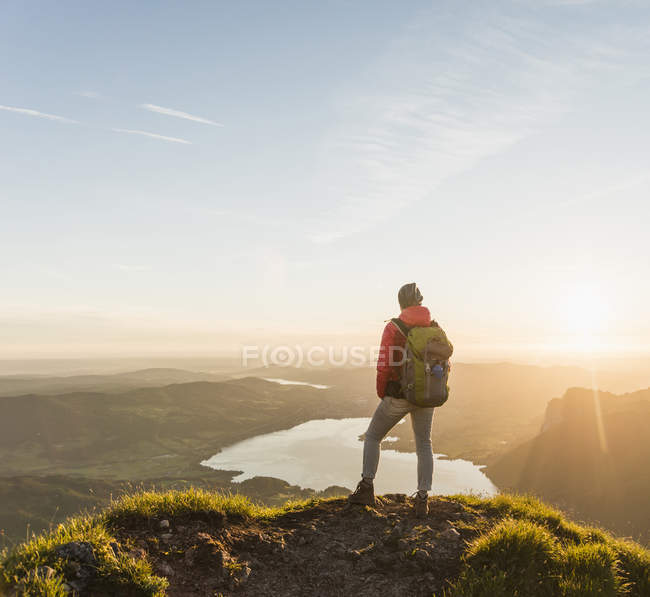 Austria, Salzkammergut, Hiker standing on summit, looking at view — Stock Photo