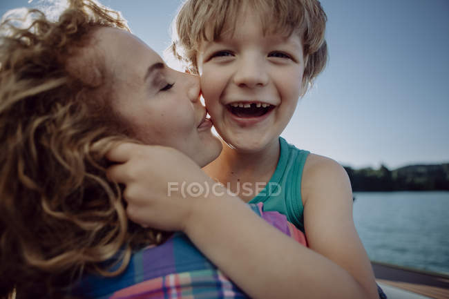 Mother and happy son at a lake — Stock Photo