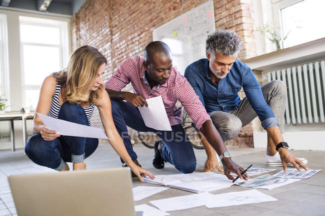 Team of architects discussing the rebuilding of a loft office — Stock Photo