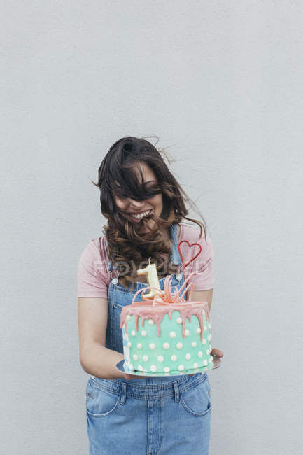 Laughing woman with Birthday cake — Stock Photo