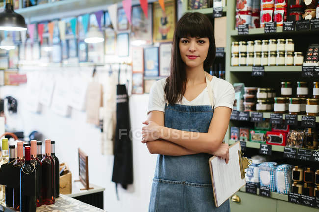 Portrait of smiling woman standing in a store — Stock Photo
