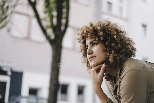Woman with hand on chin, thinking, portrait — Stock Photo