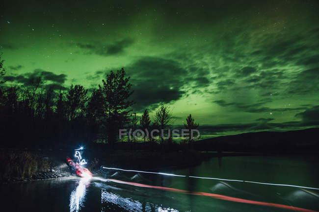 Canada, British Columbia, Boya Lake, Boya Lake Provincial Park, Northern Lights, starry sky at night, light painting — Stock Photo