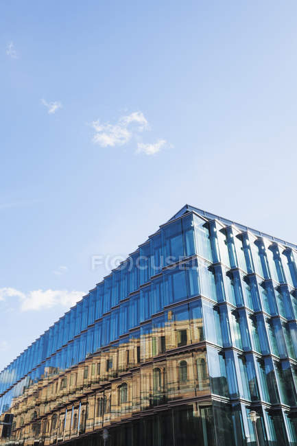 Germany, Berlin, glass front of modern building reflecting historical   architecture — Stock Photo