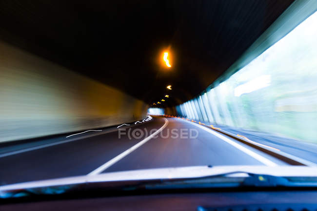 Austria, Tyrol, car driving through avalanche protection gallery — Stock Photo