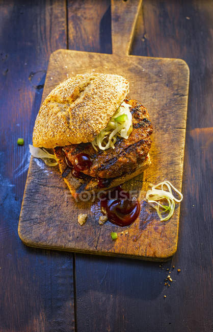 Burger on wooden board — Stock Photo