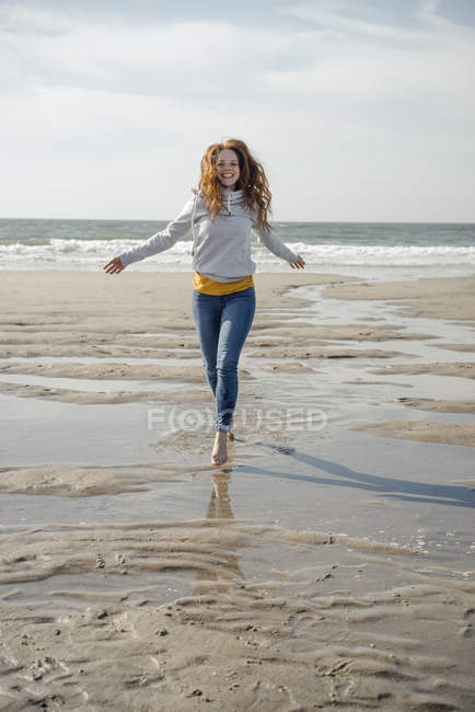Happy woman having fun at the beach, running at the sea — Stock Photo