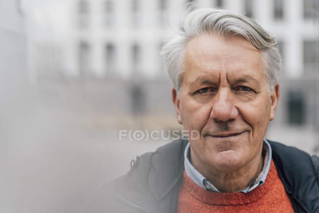 Portrait of confident senior man outdoors — Stock Photo