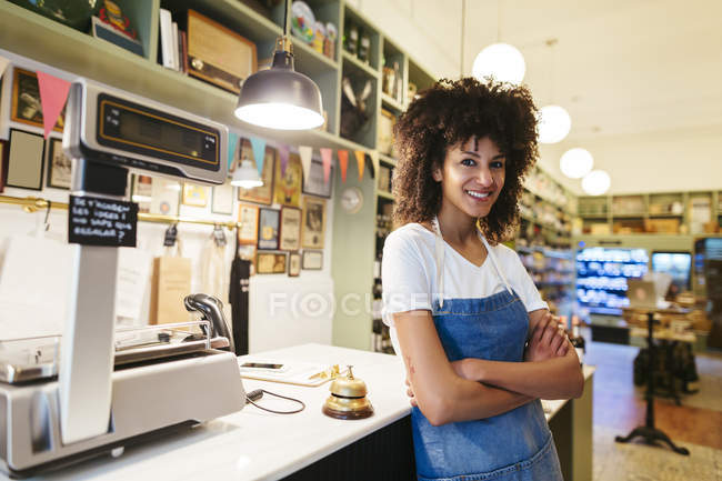 Portrait of smiling woman in a store — Stock Photo