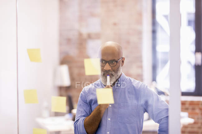 Portrait of pensive african american businessman in an office — Stock Photo