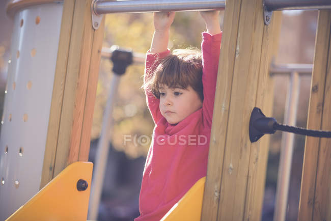 Portrait of pensive little girl on   playground — Stock Photo