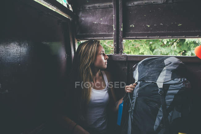 Cuba, young woman with backpack traveling on a van — Foto stock