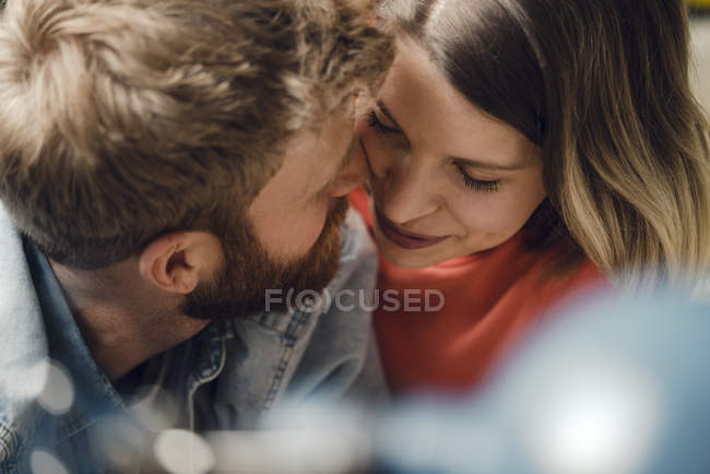 Affectionate couple cuddling at home — Stock Photo