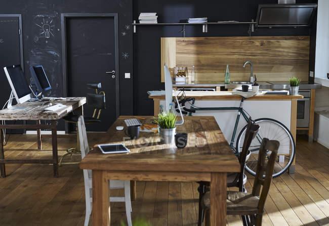 Modern office interior with kitchen — Stock Photo