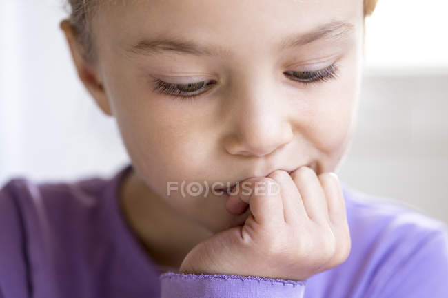 Portrait of pensive little girl, close-up — Stock Photo