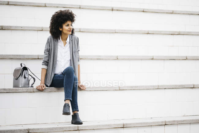 Woman resting on stairs outdoors — Stock Photo