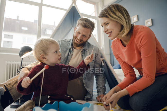 Happy family playing with their son at home — Stock Photo